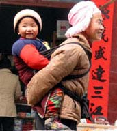 Ethnic minorities still carry their babies on their backs as they have done for generations