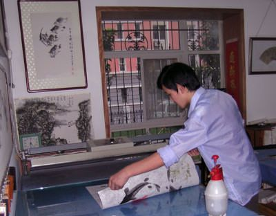 Loading the Asian artwork press