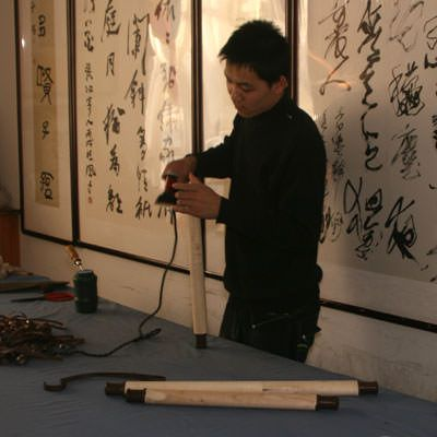 Preparing wall scroll rollers