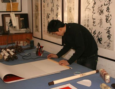 Preparing to install the top frame of the wall scroll