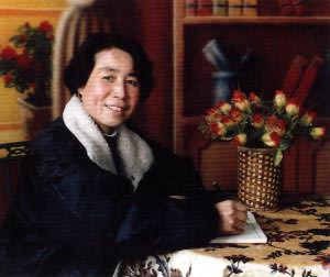 The artist Pan Xiao-Ling, who created these Chinese folk art paintings