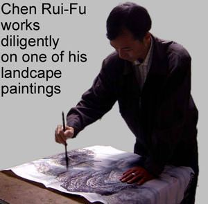The artist Chen Rui-Fu practices his art of creating beautiful Chinese landscape paintings