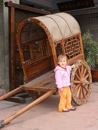 Kaili in Chinese horse drawn cart / carriage
