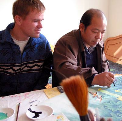 Watching Chinese Artist Mr. Ou-Yang Paint